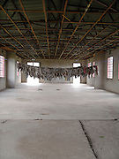 Murambi Genocide Memorial, Gikongoro, where 27000 people died during the 1994 genocide. The clothes of some of the victims hanging from a rope.
