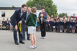 © Licensed to London News Pictures . 03/07/2014 . Leeds , UK . The Deputy Prime Minister , NICK CLEGG MP , at Ireland Wood Primary School in Leeds today (Thursday 3rd July 2014) awards a medal to Winnie Offland (eight) of Rawdon Littlemoor school for coming first in the girls' time trial . The Liberal Democrat leader and MP for Sheffield Hallam watches a Grand Depart school event with children taking part in cycling time trials and singing the the Tour de France anthem . Photo credit : Joel Goodman/LNP