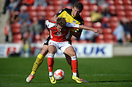 Tom Eastman of Colchester United does battle with Tom Bradshaw of Walsall during the Sky Bet League 1 match between Walsall and Colchester United at the Banks's Stadium, Walsall<br /> Picture by Richard Blaxall/Focus Images Ltd +44 7853 364624<br /> 06/09/2014