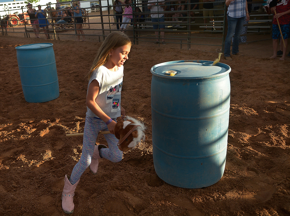 gbs072017g/RIO-WEST  -- Kendal Bonjour, 10, of Phoenix, Arizona runs the barrel race with a stick horse during the Summer Rodeo Series at the Stables at Tamaya on Thursday, July 20, 2017.(Greg Sorber/Albuquerque Journal)