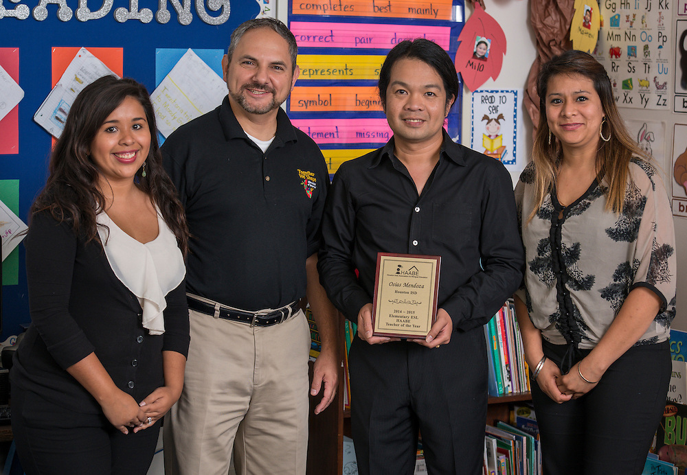 Osias Mendoza poses for a photograph with his assistants and Robert Chavarria at Love Elementary School, May 20, 2015.