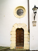 Photograph of a doorway on the side of St. Gallus Church in Augsburg, Germany.