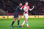 Ethan Pinnock of Barnsley (5) and Andrew Butler of Doncaster Rovers (6) in action during the EFL Sky Bet League 1 match between Doncaster Rovers and Barnsley at the Keepmoat Stadium, Doncaster, England on 15 March 2019.