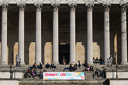 A students' banner at UCL expresses solidarity with teaching staff. Students and staff at UCL man picket lines as and estimated 40,000 University and College Union (UCU) lecturers and academics across the UK strike over changes to their pensions. The strike is the first in a planned series of 14 days of walkouts. UCL, London, February 22 2018.