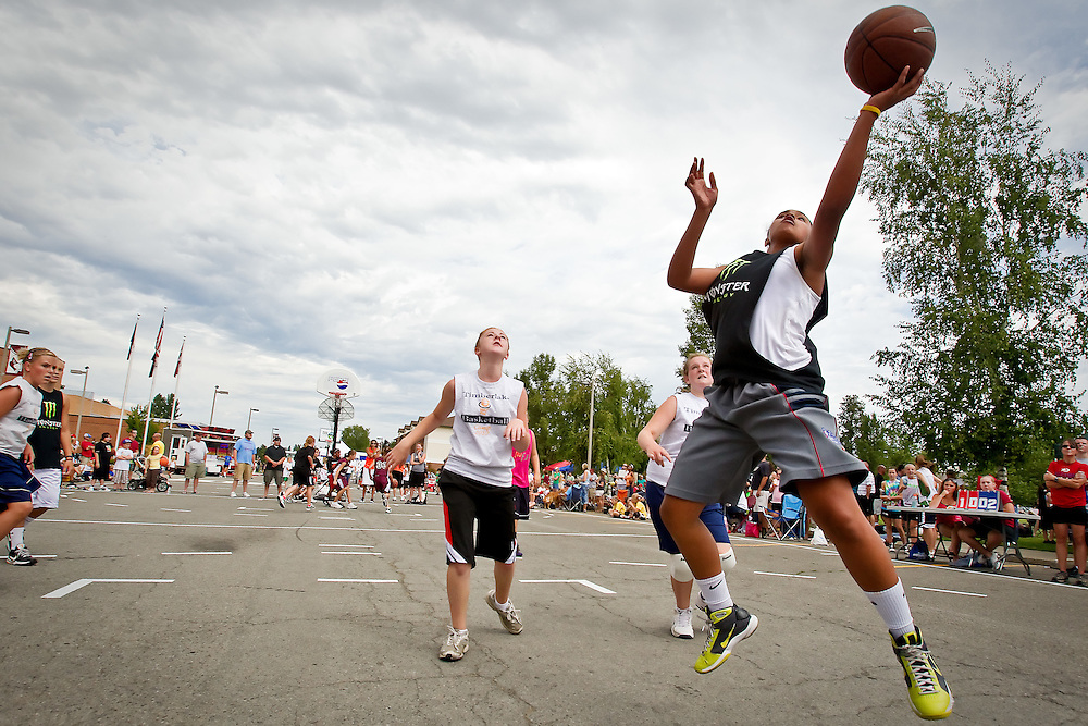 Janieva Bates, 13, with team All Net, beats the defense to the hoop during their game Saturday at the Coeur d'Alene Shootout 3-on-3 basketball tournament at North Idaho College.