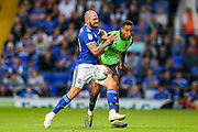 AFC Wimbledon defender Terell Thomas (6) tussles with Ipswich Town forward James Norwood (10) during the EFL Sky Bet League 1 match between Ipswich Town and AFC Wimbledon at Portman Road, Ipswich, England on 20 August 2019.