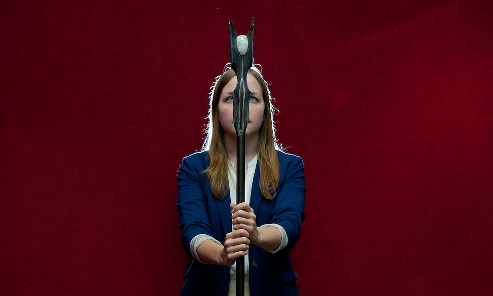 A Bonhams employee displays a wizards staff  from the Lord of the Rings movie trilogy, 31st July 2014, in Bonhams, Knightsbridge, Central London, Britain. The staff features as  part of collection of props from Sir Christopher Lee, who starred as Saruman in the films, which will go on display in London on 31st July till the 4th August before being on display in New York where they will be sold on 24th November 2014. EPA/WILL OLIVER