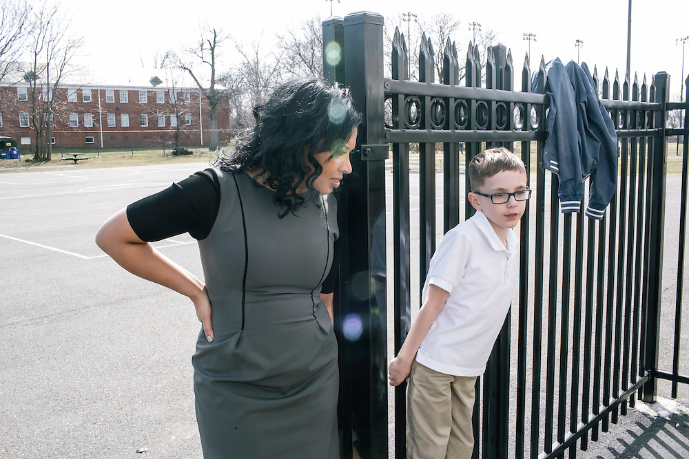 Leckie Elementary principal Atasha James, left, talks with third-grader Brian Ledbetter, 9, whose father is in the Air Force, during school on Monday, March 16, 2015.