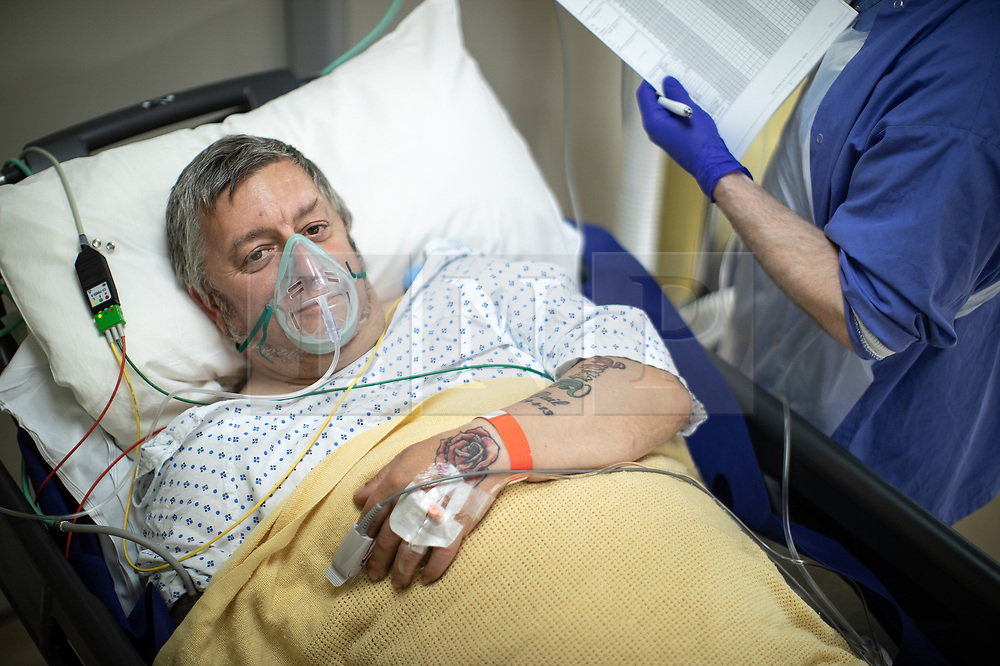 © Licensed to London News Pictures . 21/05/2020 . Manchester , UK . Patient GIOVANNI PISANI (49 from Stockport) wakes up after undergoing a biopsy to assess whether previous treatment has been successful . Specialist cancer centre , The Christie Hospital , is adapting in order to ensure the safety of patients and staff . They are reporting a drop in referrals during the UK's Coronavirus lockdown and there is concern that cancers are going undiagnosed and untreated . Photo credit : Joel Goodman/LNP