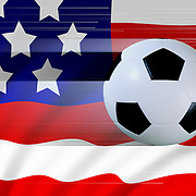 A moving soccer ball against the stars and stripes flag of America to portray football or soccer in the USA.