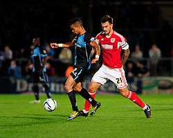 Bristol City's Marlon Pack chases down Wycombe Wanderers' Paris Cowan-Hall - Photo mandatory by-line: Joe Dent/JMP - Tel: Mobile: 07966 386802 08/10/2013 - SPORT - FOOTBALL - London Road Stadium - Peterborough - Peterborough United V Brentford - Johnstone Paint Trophy