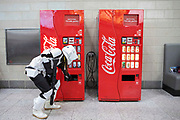 UNITED KINGDOM, London: 27 May 2018 A cosplay fan dressed as a Storm Trooper gets a refreshing drink at the MCM London Comic Con earlier today. The three day comic convention, which is held at London's ExCeL, was visited by thousands of avid cosplay fans and enthusiasts. Rick Findler / Story Picture Agency