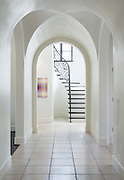 White traditional arched hallway in a Highland park custom home