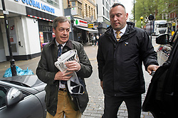 © Licensed to London News Pictures. 28/04/2019. London, UK. Brexit Party leader NIGEL FARAGE is seen being escorted by security as he leaves the studio of LBC radio in central London following interview. The Brexit Party has seen a surge in support following it's recent launch ahead of European Elections in May . Photo credit: Ben Cawthra/LNP