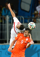 Robin van Persie of Netherlands and Michael Umana of Costa Rica during the 2014 FIFA World Cup match at the Itaipava Arena Fonte Nova, Nazare, Bahia<br /> Picture by Stefano Gnech/Focus Images Ltd +39 333 1641678<br /> 05/07/2014