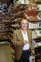 Portrait of a happy standing in front of cigar display