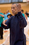 David Wong from Yang Style Tai Chi, Auckland leads performers as New Zealand starts the global relay celebrating World Tai Chi & Qigong Day 2007 which commences at 10am local time worldwide, Tamaki Community Centre, Glen Innes, Auckland, New Zealand on Saturday 28 April 2007.  Photo: David Rowland/PHOTOSPORT