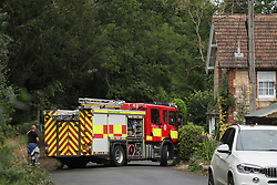 © Licensed to London News Pictures. 16/08/2020. Calne, UK. Emergency services at the scene on the A4 at Derry Hill near Calne in Wiltshire where four people have been killed in a road traffic accident in which a car is believed to have hit a house then caught fire.  Photo credit: Tim Ireland/LNP