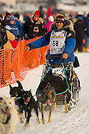 05 March 2006: Willow, Alaska - Four time champion Martin Buser waves to fans as he heads out for Nome in hopes of being the second musher to have 5 wins in the Last Great Race during the restart of the 2006 Iditarod on Willow Lake in Willow, Alaska