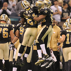 16 January 2010:  New Orleans Saints running back Reggie Bush (25) celebrates with teammates Mike Bell (21) and Pierre Thomas (23) after scoring a touchdown against the Arizona Cardinals during the first half of the 2010 NFC Divisional Playoff game at the Louisiana Superdome in New Orleans, Louisiana.
