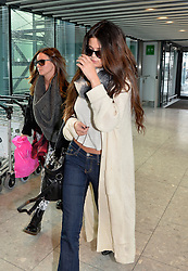 Selina Gomez (R) departs Heathrow Airport for the US, United Kingdom, Tuesday, 18th February 2014. Picture by David Dyson / i-Images