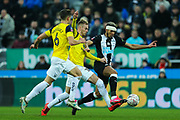 Joelinton (#9) of Newcastle United on the ball under pressure from Alex Rodriguez (#6) of Oxford United and Mark Sykes (#18) of Oxford United during the The FA Cup match between Newcastle United and Oxford United at St. James's Park, Newcastle, England on 25 January 2020.