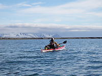 A kayaker in calm weather outside the Mitra peninsula on Spitzbergen