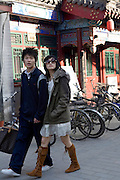 A young couple shop together in Nanluoguoxiang, an area popular for shopping and dining in central Beijing.