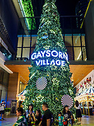 23 NOVEMBER 2018 - BANGKOK, THAILAND:  People walk past the Christmas tree set up at the entrance to Gaysorn, an exclusive mall in Bangkok. Although Thailand is an overwhelmingly Buddhist country, the commercial aspects of Christmas are widely observed, especially in Thailand's urban areas, which have large concentrations of Europeans and Americans.    PHOTO BY JACK KURTZ