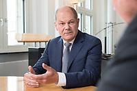25 JUN 2018, BERLIN/GERMANY:<br /> Olaf Scholz, SPD, Bundesfinanzminister, waehrend einem Interview, in seinem Buero, Bundesministerium der Finanzen<br /> IMAGE: 20180625-02-003<br /> KEYWORDS: B&uuml;ro