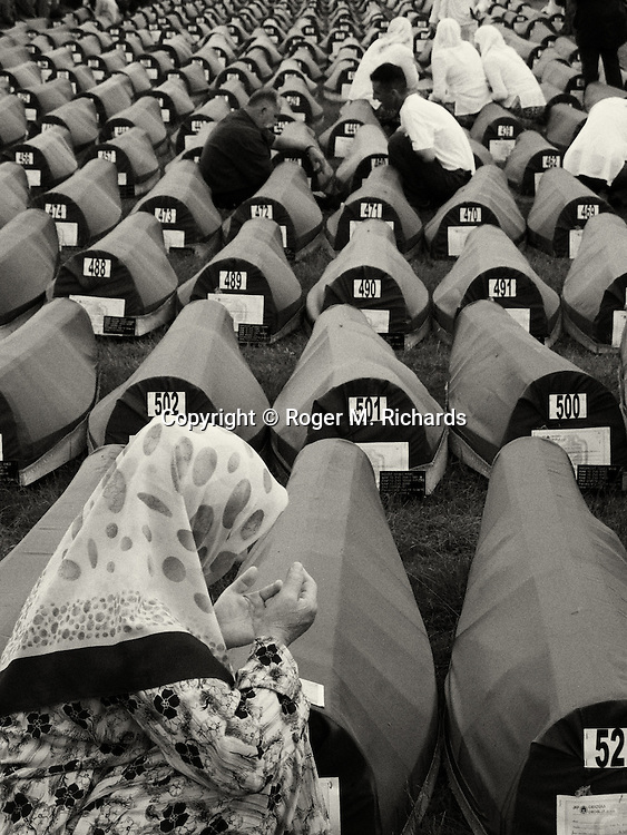 Mourning the dead at a mass burial for 535 newly identified victims of the Srebrenica genocide, in Srebrenica, Bosnia, July 10, 2009.
