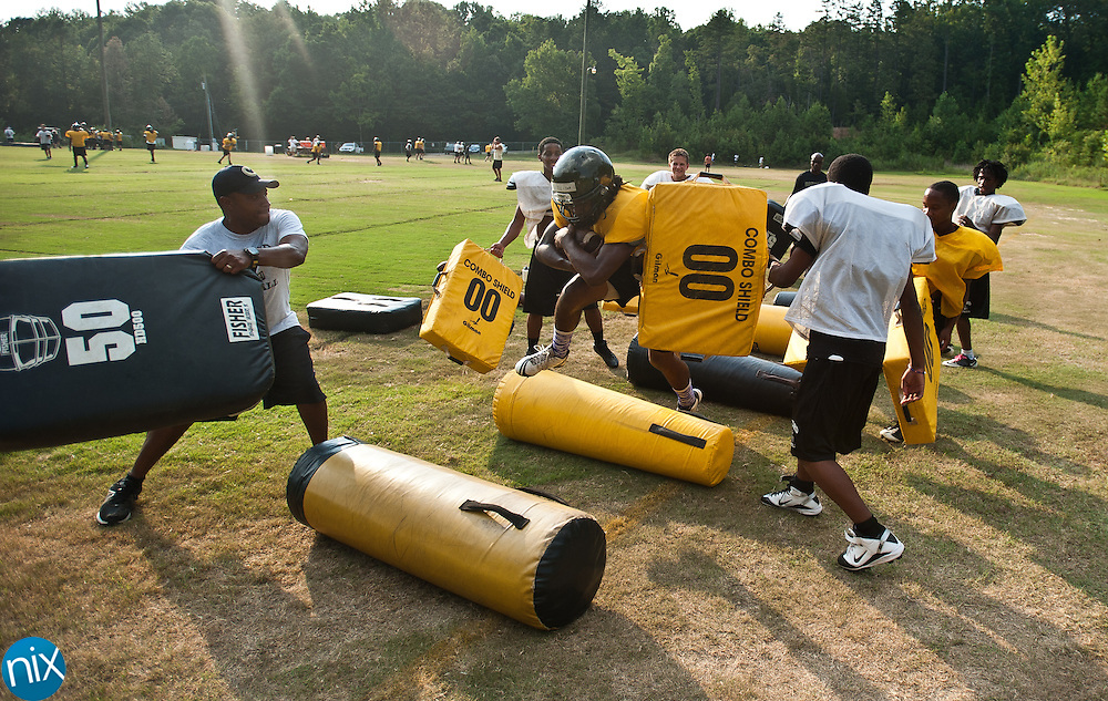 Concord running back Rocky Reid runs through a gauntlet of teammates during a drill at football practice Thursday, August 2 at Concord High School. (photo by James Nix)