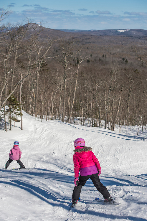 Young skiers on the open runs of Mount Bohemia ski area in Michigan.