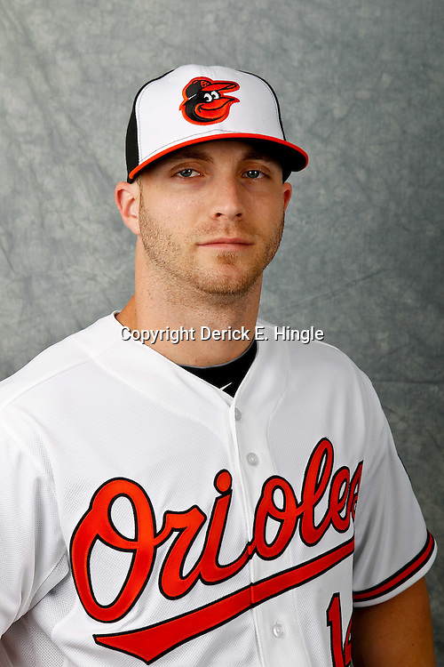 March 1, 2012; Sarasota, FL, USA; Baltimore Orioles left fielder Nolan Reimold (14) poses for a portrait during photo day at the spring training headquarters.  Mandatory Credit: Derick E. Hingle-US PRESSWIRE