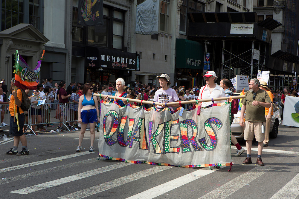 The Quakers march carrying a colorful banner. At the time of the Stonewall riots in 1969, the Quakers were the only group to offer sanctuary.