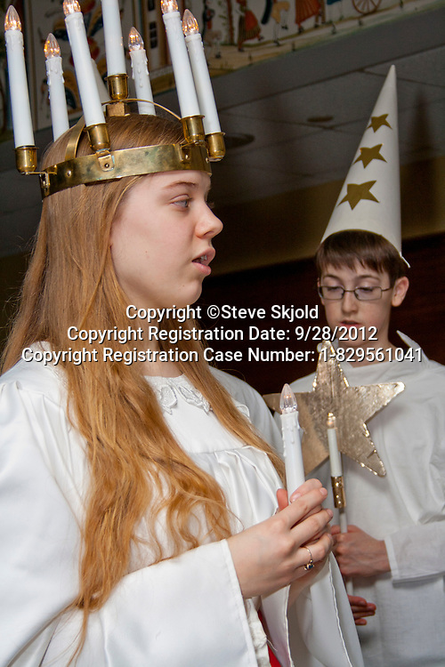 St Lucia wearing crown of candles. Annual Swedish Christmas Julbord at American Swedish Institute Minneapolis Minnesota MN USA