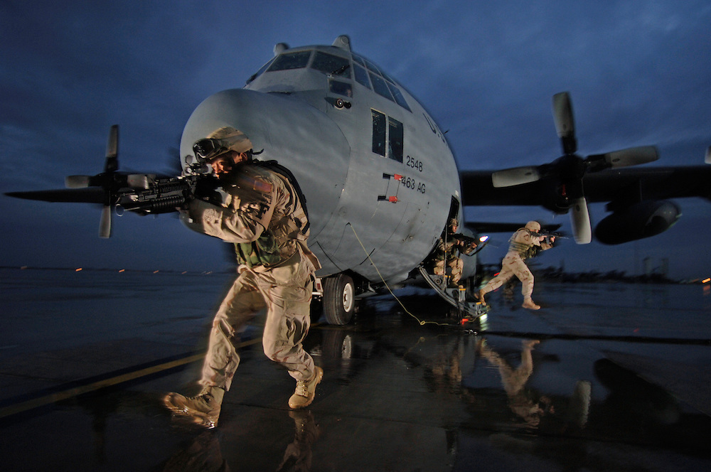 (left-right) Staff Sgt. Tony Rivera, Senior Airmen Jason Bauer, and Darryll Morley, with Staff Sgt. Jason Sawyers (at the rear of the aircraft), deployed to 332nd Expeditionary Security Forces Squadron, flyaway security team provides dedicated aircraft security for the C-130 Hercules aircraft of the 386th Expeditionary Airlift Squadron, Detachment 1 at Balad Air Base.  Part of the transformation of Security Forces is adapting themselves to the needs of the mission. For aircraft that frequently have short notice missions into hostile airfields, the 332nd ESFS created an additional duty team to provide specialized short notice aircraft security support and flight deck denial in the case of detainee transport. The aircraft are from the 463rd Airlift Group, Little Rock Air Force Base, Ark. The security team personnel are assigned to Shaw, Whitman, and Dyess Air Force Bases. Training exercise.  (U.S. Air Force photo by Master Sgt. Lance Cheung)