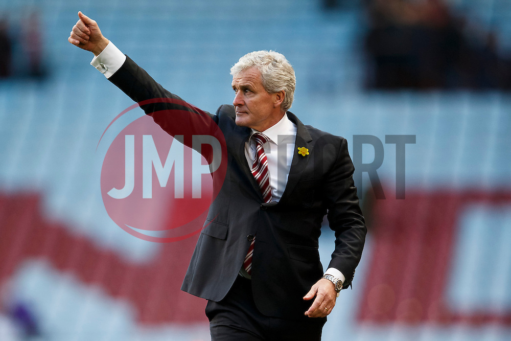 Stoke Manager Mark Hughes (WAL) shows his thanks to the travelling supporters after their sides 1-4 victory - Photo mandatory by-line: Rogan Thomson/JMP - 07966 386802 - 23/03/2014 - SPORT - FOOTBALL - Villa Park, Birmingham - Aston Villa v Stoke City - Barclays Premier League.