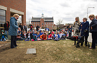 Pam Clark talks with 3rd grade students from Pleasant Street School with Samantha Jewett, Mary Orton and Ann Kaligian looking on before digging up the 1993 time capsule at Laconia City Hall on Wednesday afternoon.   (Karen Bobotas/for the Laconia Daily Sun)