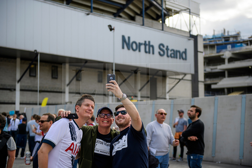 © Licensed to London News Pictures. 14/05/2017. London, UK. Fans pose for a selfie outside White Heart Lane, in North London where Tottenham Hotspur F.C. are playing their final game at the ground, against Manchester united today (Sun). Known as 'The Lane', Tottenham have been playing at the ground for 118 years, but will be playing at Wembley next season while a new 60,000 seat stadium is built for the start of the 2018/19 season.  Photo credit: Ben Cawthra/LNP