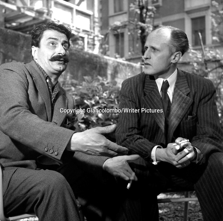 Giovannino Guareschi &amp; painter Giuseppe Novello in Milan<br /> 1952<br /> <br /> Photograph by Giancolombo/Writer Pictures<br /> <br /> WORLD RIGHTS, NO AGENCY, NO ITALY
