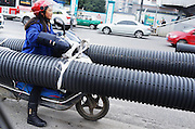 "GUIYANG, CHINA - DECEMBER 10: (CHINA OUT) <br /> <br /> Woman rides motorbike carrying hugh tubular products<br /> <br /> A woman rides a motorcycle carrying tubular products at Baoshan North road on December 10, 2014 in Guiyang, Guizhou province of China. A woman rides a motorcycle carrying tubular products was called ""The best motorcycle rider"" in Guiyang on Wednesday. <br /> ©Exclusivepix Media"