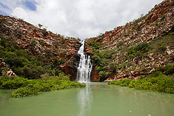 Water cascades over Oyster Falls in Talbot Bay in the 2011 wet season.