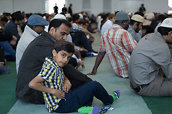 Image ©Licensed to i-Images Picture Agency. 27/06/2014. Morden, United Kingdom. British Muslims condemn Isis at Friday prayers in LND Mosque. A young boy among hundreds of Ahmadiyya Muslim worshippers gather at the Baitul Futuh mosque in Morden - the largest mosque in western Europe - to for Friday prayers as Islamic Caliph condemns ISIS and extremism. Baitul Futuh Mosque. Picture by Daniel Leal-Olivas / i-Images