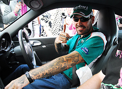 Boyzone's Shane Lynch driving a Matte Balck Porsche arrived into Westport as part of the Canonball 2010. Over 160 cars took part in the race that raises funds for Barrettstown ...Pic Conor McKeown