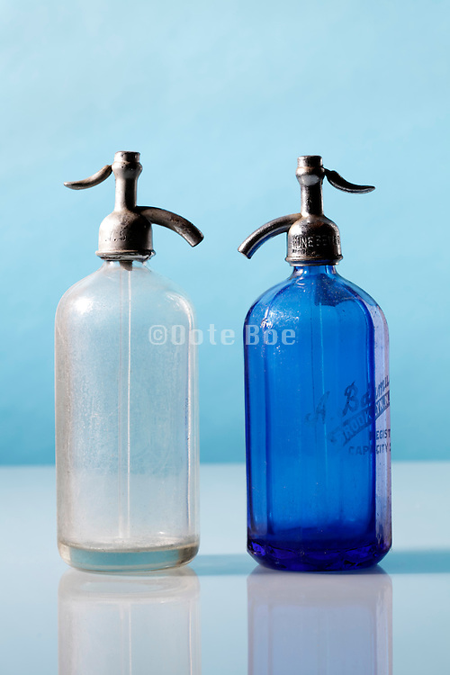 two old antique seltzer water bottle