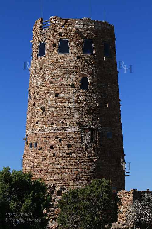 Mary Colter's Watchtower, built 1932 in style of Mesa Verde towers, looms skyward at Desert View on the South Rim of Grand Canyon National Park, Arizona.