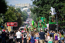 © Licensed to London News Pictures. 29/08/2016. London, UK. A Brazilian carnival float passes along the top of Ladbroke Grove as carnival goers enjoy day two of the Notting Hill carnival, the second largest street festival in the world after the Rio Carnival in Brazil, attracting over 1 million people to the streets of West London.  Photo credit: Ben Cawthra/LNP