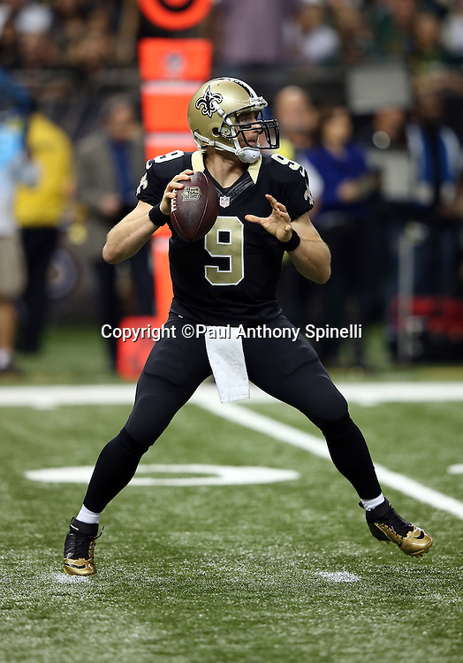 New Orleans Saints quarterback Drew Brees (9) throws a pass during the NFL week 8 regular season football game against the Green Bay Packers on Sunday, Oct. 26, 2014 in New Orleans. The Saints won the game 44-23. ©Paul Anthony Spinelli