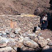 2-4 December 1976<br /> Detail of exterior entrance fa&ccedil;ade of Pashai village home.
